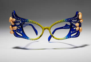 Photo of Spectacles worn by Barry Humphries as Dame Edna Everage, designed by Stephen Adnitt, made by Anglo-American Optical, 1997, UK. Museum no. S.155-2017. © Victoria and Albert Museum, London