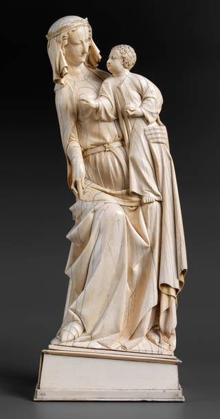 Photo of The Virgin and Child, statuette, about 1310 – 20, Paris, France, ivory. Museum no. 4685&:2-1858. © Victoria and Albert Museum, London