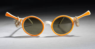 Tennis Rackets, plastic sunglasses with net and pearls, Oliver Goldsmith Eyewear, 1956, England. Museum no. T.243E-1990. © Victoria and Albert Museum, London T.243E-1990. © Victoria and Albert Museum, London