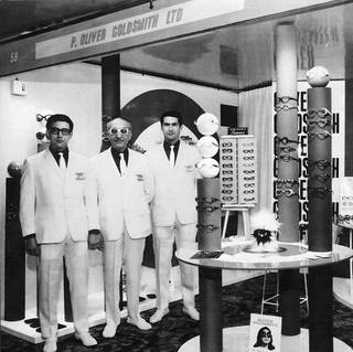 Oliver Goldsmith and sons Andrew and Ray at an eyewear trade show. © Oliver Goldsmith Eyewear