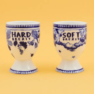 Two white and blue eggcups.  One says 'HARD BREXIT' and has acorns and leaves. The other says 'SOFT BREXIT' and has clouds