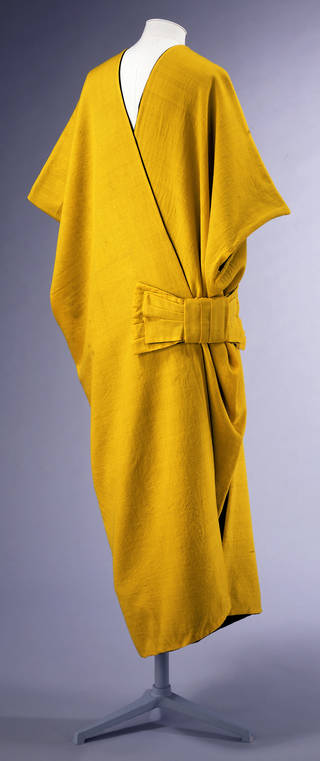 Silky golden-yellow mantle with loose bow at the hip