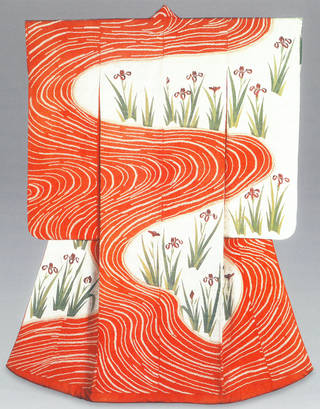 Kimono with an orange and white swirling pattern. White areas around the swirling have orange flowers with green stems.