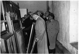 """Adolf Hitler inspecting confiscated artworks, 13 January 1938 (Aktion """"Entartete Kunst""""), photograph by Heinrich Hoffmann. © bpk, Bayerische Staatsbibliothek, Archiv Heinrich Hoffmann"""