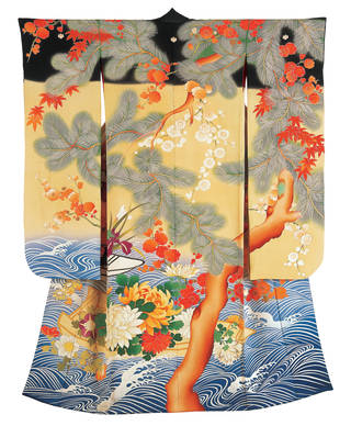 Kimono with a tree branch growing up it, a blue ocean pattern at the bottom, flowers and red leaves throughout.