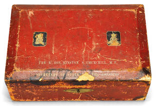Worn square, red box with lock on the front. ER royal insignia and Winston Churchill's name on the top in gold writing