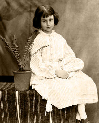 Alice Liddell aged 7, photographed by Charles Dodgson (Lewis Carroll) in 1860. Wikimedia commons.