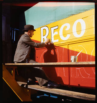Signpainting, photograph by John Hinde, about 1943, Britain. Museum no. RPS.1198-2019. © Victoria and Albert Museum, London