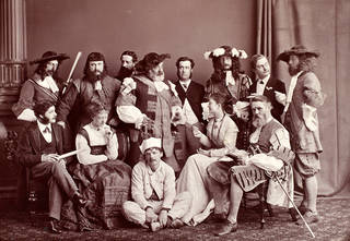 Photograph of Robert Pritchett, Shirley Brooks, Arthur Lewis, Mark Lemon, Quintin Twiss, John Tenniel, Arthur Cecil, Henry Silver, Arthur Sullivan, Ellen Terry, George du Maurier, Kate Terry and Tom Taylor at the benefit for Mrs Bennett, 1866, England. Bequeathed by Guy Little. Museum no. S.133:137-2007. © Victoria and Albert Museum, London