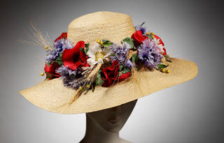 Natural straw broad-brimmed hat with fabric flowers, designed by Aage Thaarup, 1965 – 69, England. Museum no. T.261-1985. © Victoria and Albert Museum, London
