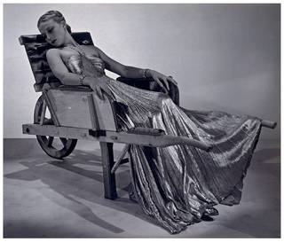 Model wearing Vionnet evening gown with 'Brouette' by Oscar Dominguez, photograph by Man Ray, 1937, France. Museum no. PH.240-1985. © Victoria and Albert Museum, London
