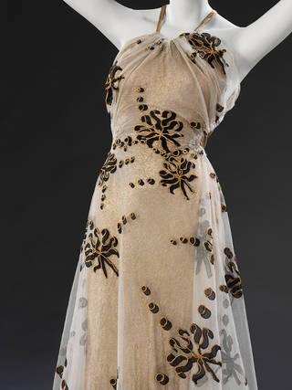 Gold lamé evening dress, Madeleine Vionnet, 1937 – 38, France. Museum no. T.35-1977. © Victoria and Albert Museum, London