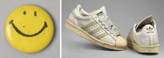 (Left to right:) Small circular pin badge with a 'Smiley Face', by Button Up, mid-1980s, New York, US. Museum no. T.48-2014. © Victoria and Albert Museum, London; Trainers, Adidas, part of an outfit that was worn by DJ Slamma, 1994, Britain. Museum no. T.980:1, 2-1994. © Victoria and Albert Museum, London