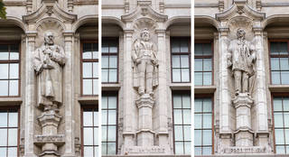 Left to right: Statue of George Frederic Watts by Richard Reginald Goulden, Cromwell Rd façade, 1905 – 6; statue of William Morris by Arthur George Walker, Exhibition Road façade, 1905 – 6; statue of Alfred Stevens by James Gamble, Cromwell Rd façade, 1905 –6. © Victoria and Albert Museum, London