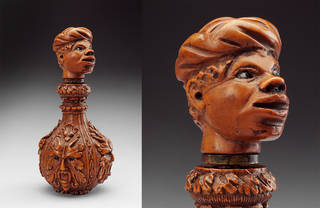 Wooden scent flask with carved stopper in the shape of an African man's head