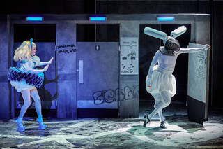 Carly Bawden as 'Alice' and Joshua Lacey as the white rabbit in Wonder.land at the Royal National Theatre
