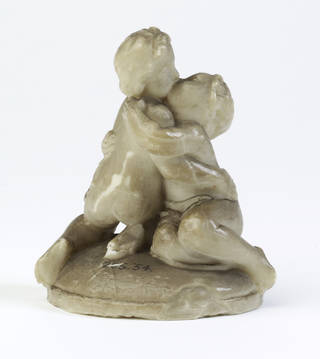 Wax model of two children embracing