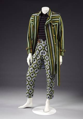 black, brown, green and white striped cotton trench coat with belt, blue-grey poplin trousers with a black and yellow pattern