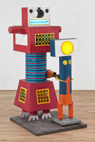 Red and blue robot figure made out of shapes. Smaller orange and blue robot figure next to it