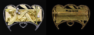 Gold and silver brooch with a relief of young women, framed by diamonds and decorated with a sprig of mistletoe in enamelled gold and pearls. Also shows reverse of brooch with pin