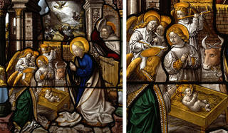 Stained glass window showing a nativity scene with Mary and angels around baby Jesus