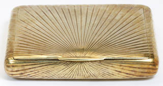 Gold cigarette case engraved with radiating straight lines