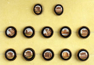 Twelve round tie pin heads featuring micromosaic designs of classic Italian architecture surrounded by a black border