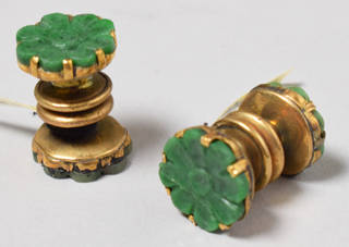 Pair of gold cufflinks with green jade flower centres