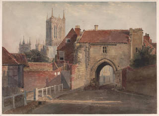 Watercolour showing a road leading beneath a gate-house, with Lincoln cathedral visible in the background.