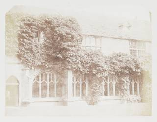 Salted paper print of the cloisters at Lacock Abbey in pale browns and creams