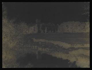 Calotype of a view of Lacock Abbey; reddish brown colour.