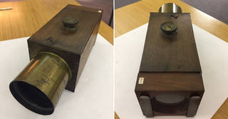 Wooden camera with large brass lens. Composite image showing front and back view.