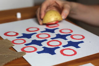 Potato print of blue cross and red circle pattern