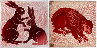 Two tiles showing animal designs on red patterned backgrounds