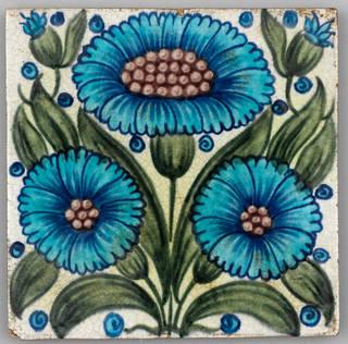 Tile with blue flower design