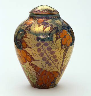 Vase and cover with  gold, orange and purple botanical designs