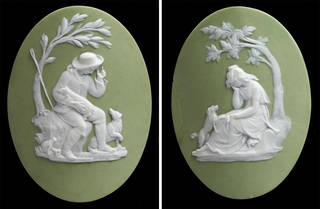 Left: Jasperware buckle ornament, oval in shape and with relief of a shepherd seated beneath a tree, in white on an olive-green ground. Right: the same but featuring a woman.