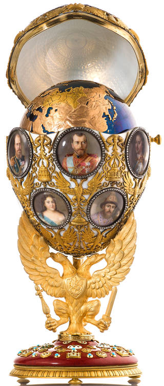 Elaborate open gold Faberge easter egg on stand with portraits of the Russian royal family on surface, showing globe within