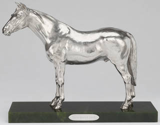 Silver statuette of a horse called Persimmon on a green nephrite stand