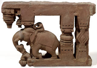 Architectural bracket in the shape of an elephant made from red sandstone