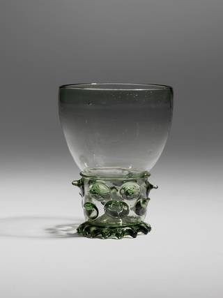 Drinking glass with applied prunts (spiky detailing) on the stem, and trailed and tooled footrim