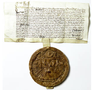 Circular brown wax seal with image of Elizabeth I attached to a white document with black written text on it.