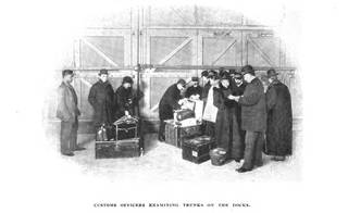 Black and white image of travellers having their luggage checked by customs men