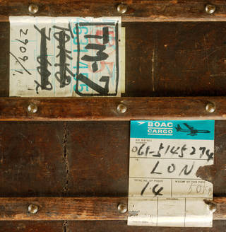 Two paper BOAC labels on a brown studded background