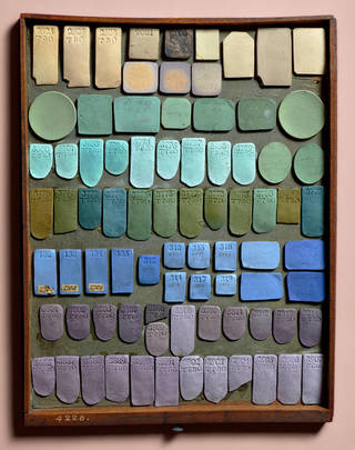 Tray of cream, turquoise, green, blue and purple pieces of ceramic