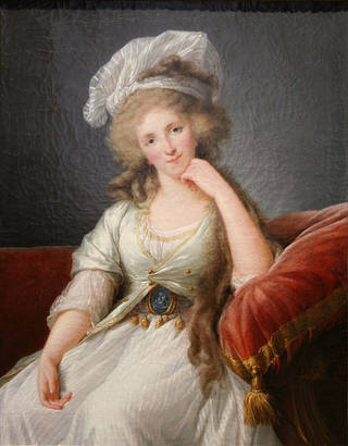 Painting of a woman sitting in a red chair, with her hand on her chin. She has long hair and wears a white hat and white dress.