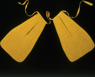 Pair of bright yellow pockets on a black background