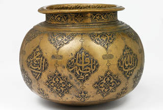 Brass vase in a round shape with engraving