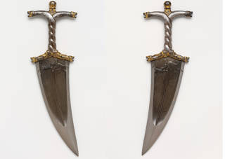 IMage showing both sides of a metal dagger with slightly curved blade and twisted handles.