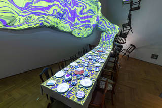Interior exhibition view showing the digital tea-party projection
